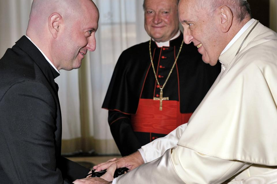 Pope Francis blessing the headphones of Padre Guilherme Peixoto